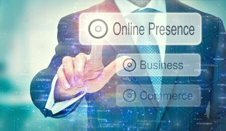A business man selection a Online Presence button on a futuristic display with a concept written on it.