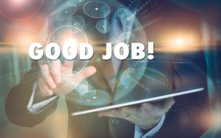 A hand selecting a Good Job business concept on a futuristic computer display. Stock Photo