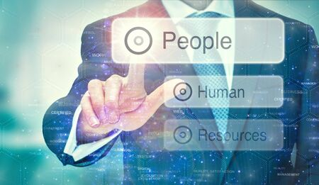 A business man selection a People button on a futuristic display with a concept written on it.