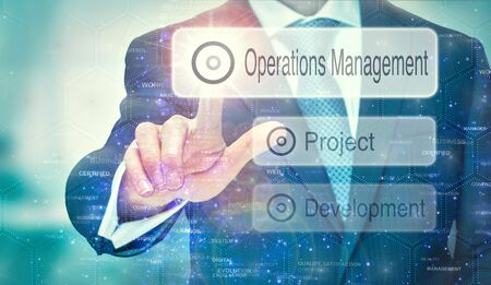 A business man selection a Operations Management button on a futuristic display with a concept written on it.