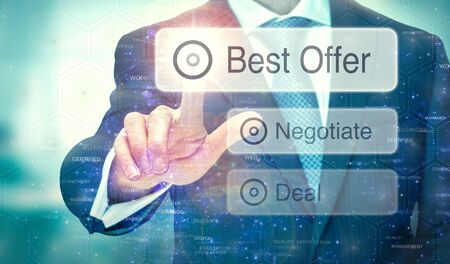 A businessman selecting a button on a futuristic display with a Best Offer concept written on it. Stock Photo
