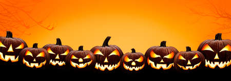 Nine halloween, Jack O Lanterns, with evil spooky eyes and faces isolated against a orange and yellow lit background. Stock Photo