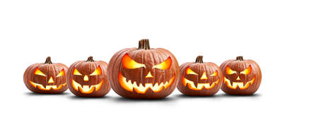 A group of five lit spooky halloween pumpkins, Jack O Lantern with evil face and eyes isolated against a white background. Stockfoto