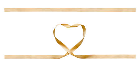 A curly gold heart shape ribbon for Christmas and birthday present banner set isolated against a white background.
