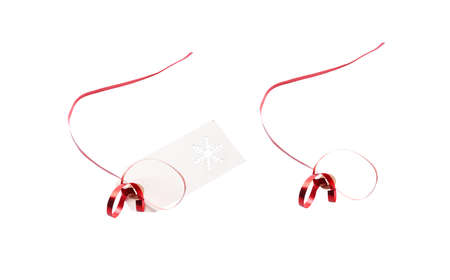 Gift tags and label template with red ribbon attached to add to presents, Christmas or birthday gifts isolated against a white background.