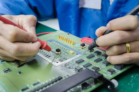 industrail: engineer measuring multimeter panel board