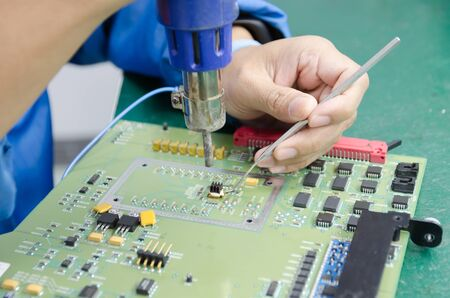 industrail: Man Remove part electronic with hot air Stock Photo