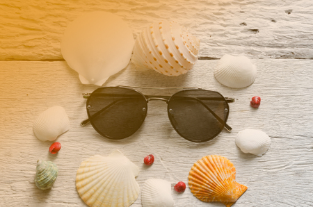 old items: Summer holiday background, Beach accessories on white wood table, Vacation and travel items