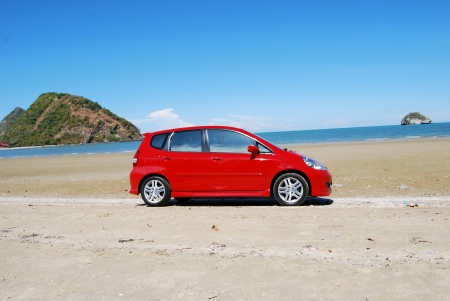 sea side: Red car on the beach