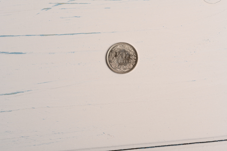 A 50 centimes Swiss coin lying on a wooden table 免版税图像