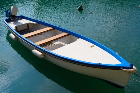 A small boat with external engine on Lake Garda in Italy