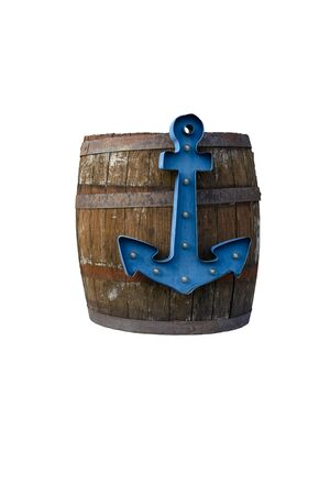 An old barrel with a blue anchor isolated. Фото со стока