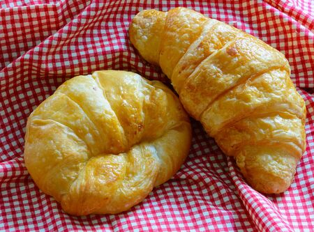 handkerchief: Croissant are placed on the Scottish red handkerchief Stock Photo