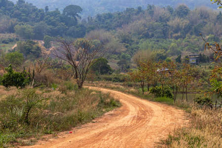 A dirt road in the countryside in the mountains of Thailand