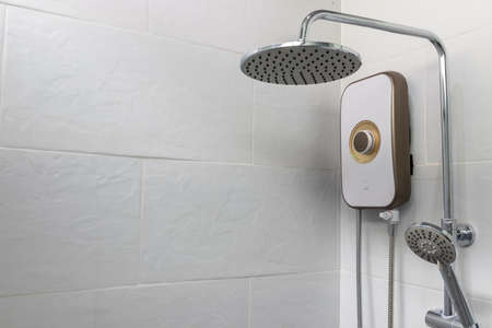 Close-Up Shower and water heater in a white bathroom. Reklamní fotografie