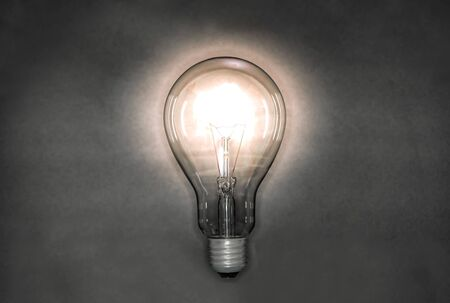 Image of a light bulb emitting light in a night background Stock fotó