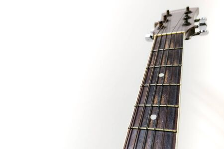 Guitar neck and free space on a white background