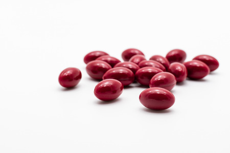 Red pills on white background Stock Photo