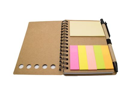 postit note: Open recycle paper spiral notebook with colorful post-it note and pen isolated on white background Stock Photo