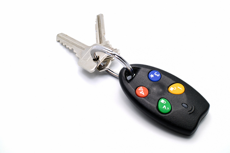 Used remote control house or car keys chain for activate security alarm. Stock Photo