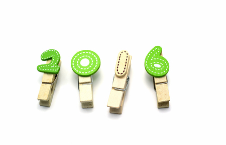 Number 2016 wooden clip on white background