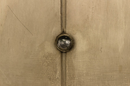 eye hole: old wooden door with eye hole.
