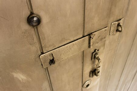 eye hole: old wooden door with handle, lock, and eye hole. Stock Photo