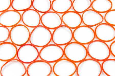 rubber bands: Red rubber bands in pattern on white background Stock Photo
