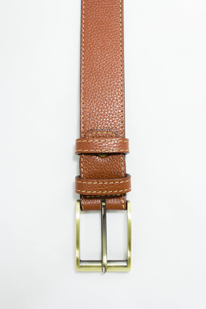 buckle: Brown leather belt with brass buckle on white background.