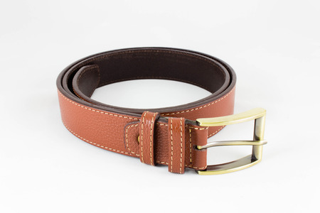 buckle: Brown leather belt with brass buckle on white background Stock Photo