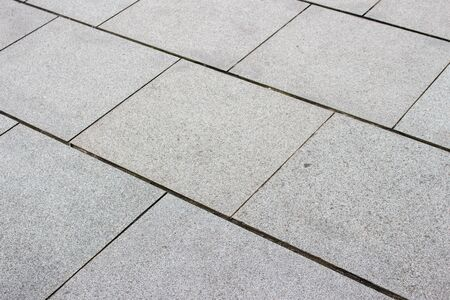 piso piedra: piso de piedra de forma cuadrada Foto de archivo