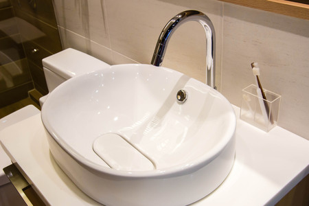 water sink: clean water sink and toothbrush