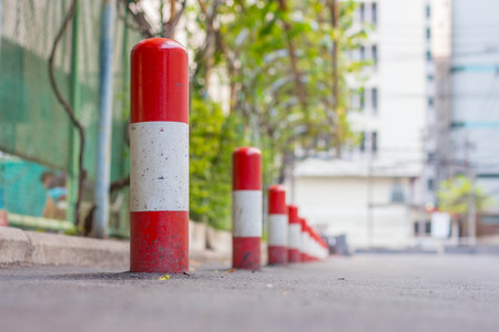 straight line: Road block pole in straight line Stock Photo