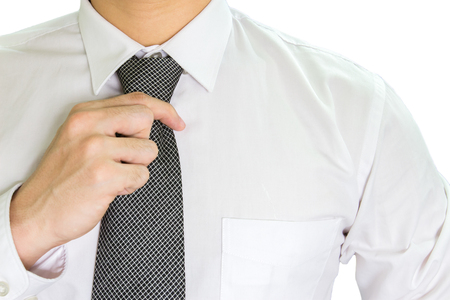 Man on a white T-shirt wearing black neck tie on white background