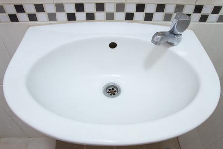 water sink: White water sink in restroom Stock Photo
