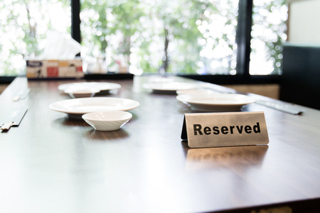 private party: Reserver sign on the table inside restaurant Stock Photo