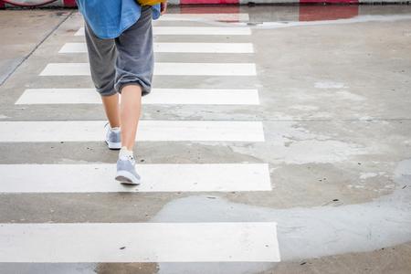 crosswalk: Walking across the road on crosswalk