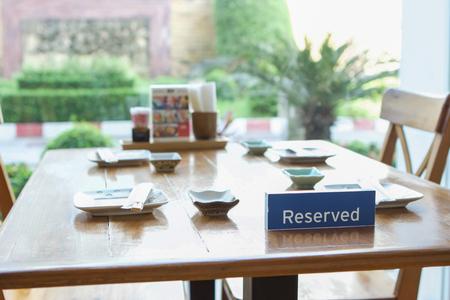 reserved sign on table inside restaurant