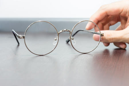 Clear circular glasses on the table with blurry background Stock Photo