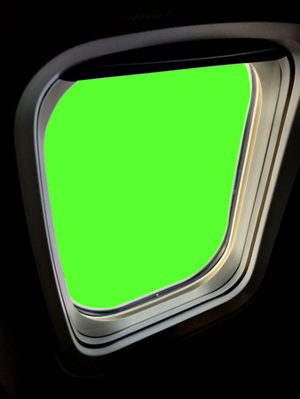 Green background outside airplane window Stock Photo