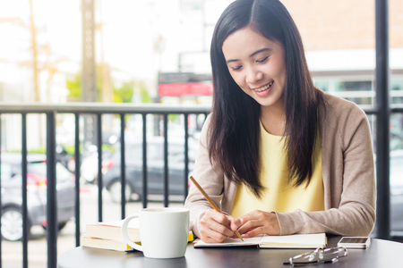 Asian woman working on document on the table