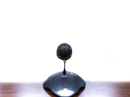 Black microphone on table with with background