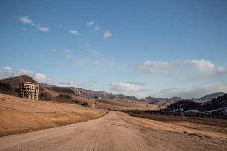 Sand road track outside country with mountain and blue sky 写真素材