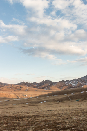 View of land, mountain and cloudy sky outside the city of Ulaanbaatar, Mongolia