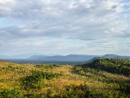 Landscape view of forest, mountain, and cloudy sky at border of Thailand and Lao Banque d'images