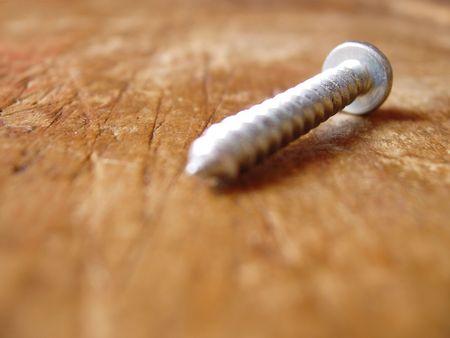 2x4: screw on weathered piece of wood Stock Photo