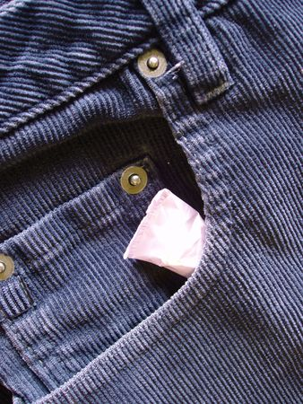 cottonwool: tampon tucked in front pocket of pants Stock Photo