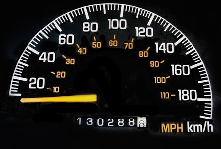speedometer with miles and kilometers on black background Stock Photo - 509574