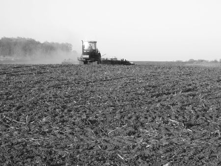 farmer ploughing his field - Southwestern Ontario photo
