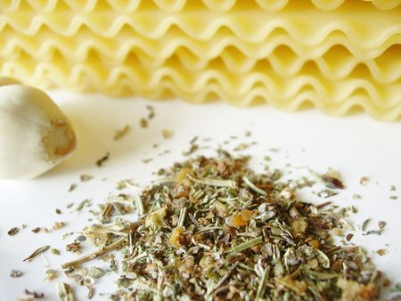 uncooked lasagna noodles, fresh garlic and italian spices - ingredients for baking lasagna Stock Photo - 532345